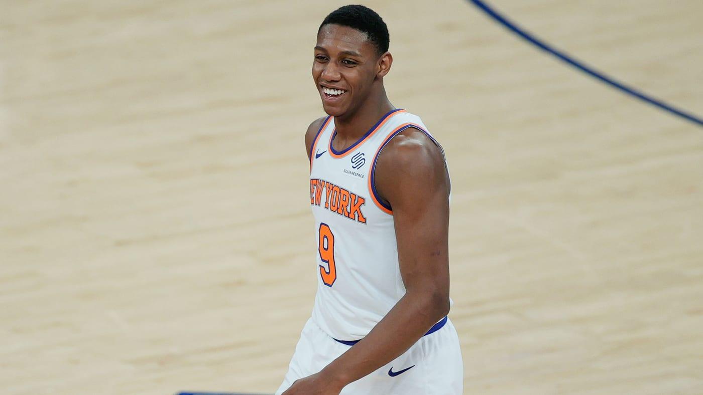 New York Knicks star RJ Barrett smiles during a game