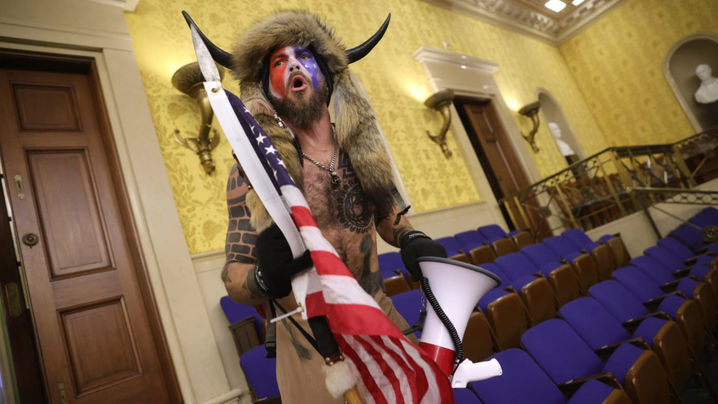 "Protester screams ""Freedom"" inside the Senate chamber after the U.S. Capitol was breached."
