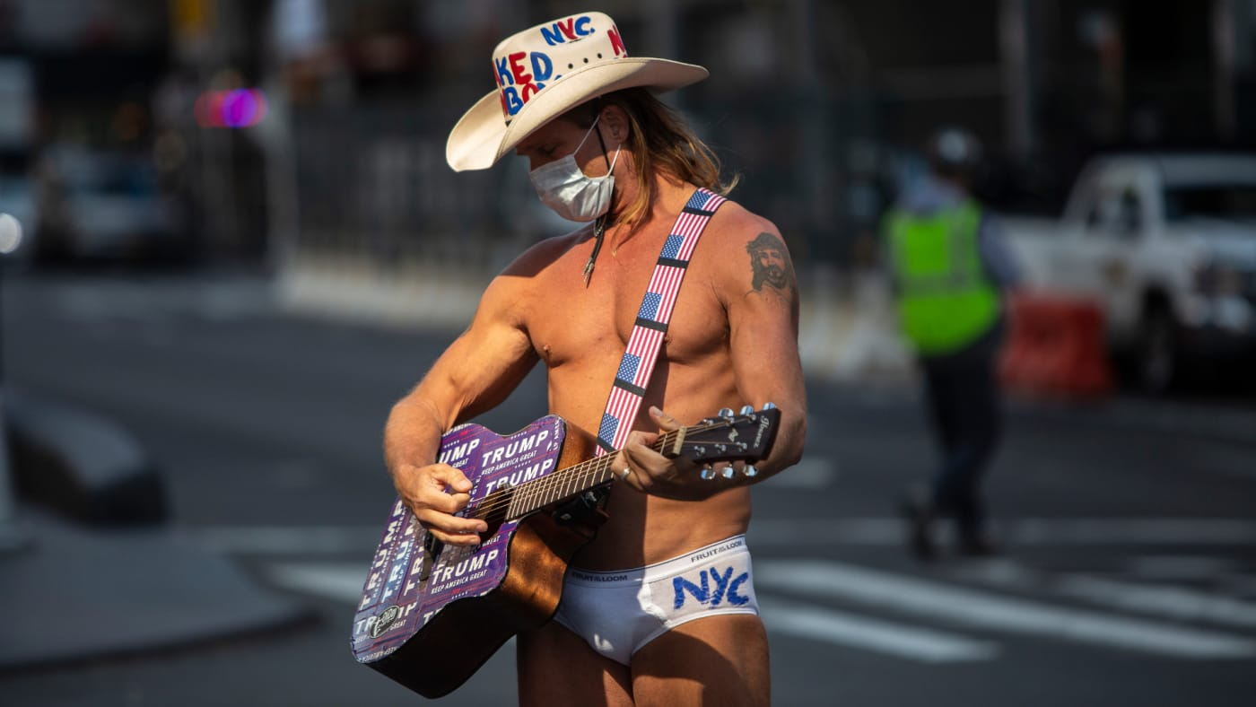 The Naked Cowboy greets tourists as Times Square is mostly empty.