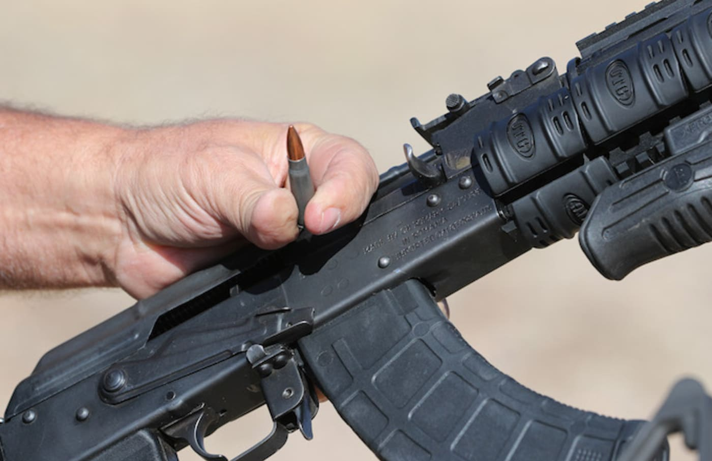 """CEO of """"Shelter in Place"""" Jim Haslem, shows off a 7.62 round for an AK 47 assault rifle."""