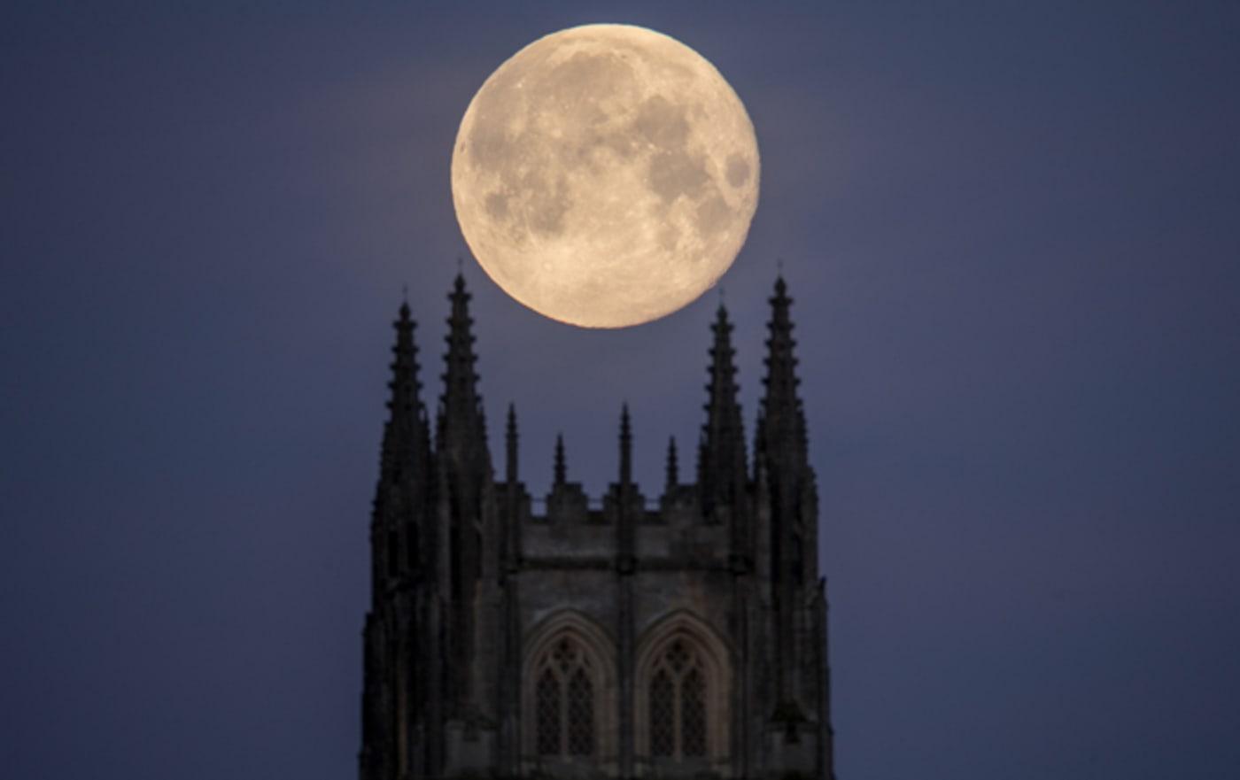 A Super Blue Blood Moon sets behind Downside Abbey