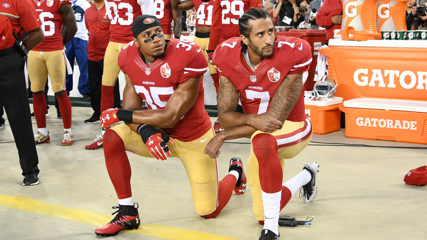 Colin Kaepernick and Eric Reid kneel in protest during the national anthem.