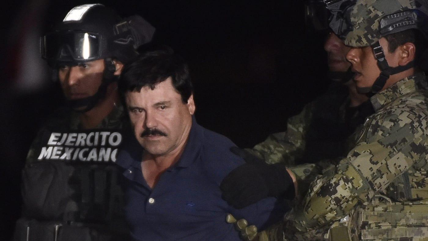 "Joaquin ""El Chapo"" Guzman is escorted to a helicopter."