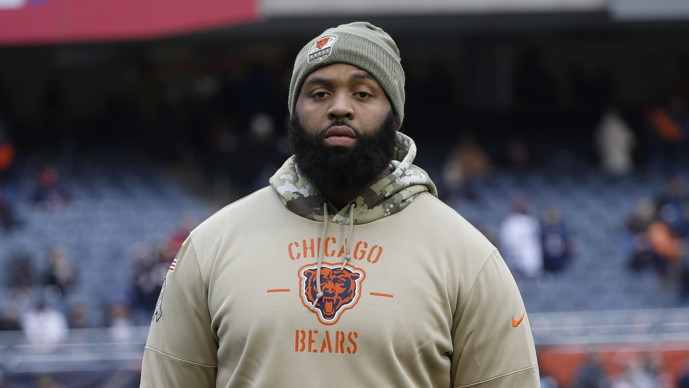 Akiem Hicks stands on the field prior to a game against the Detroit Lions.