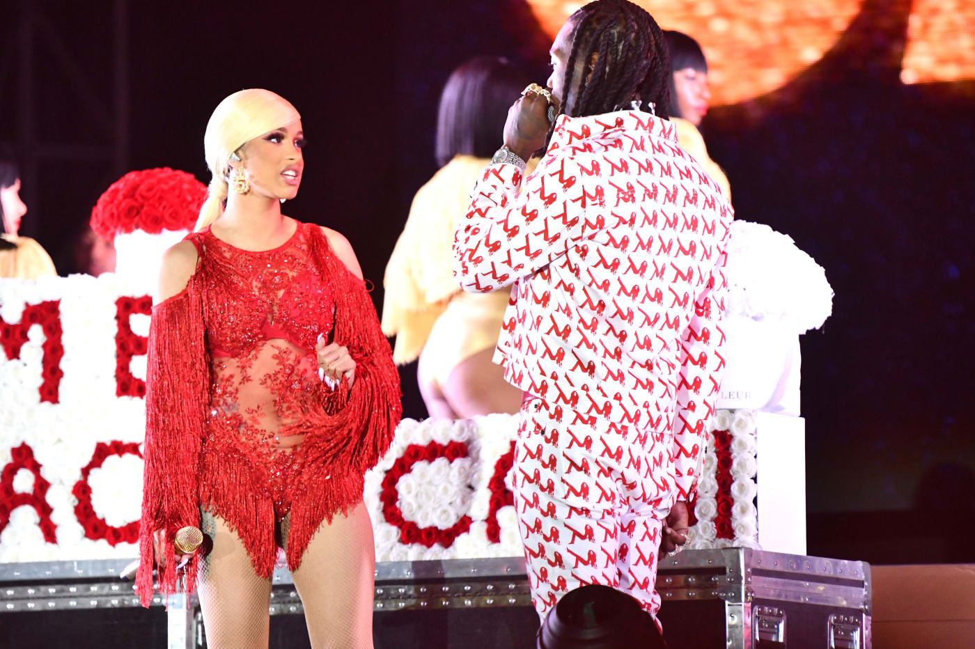: Singer Cardi B is presented a 'Take Me Back' card onstage by Offset.