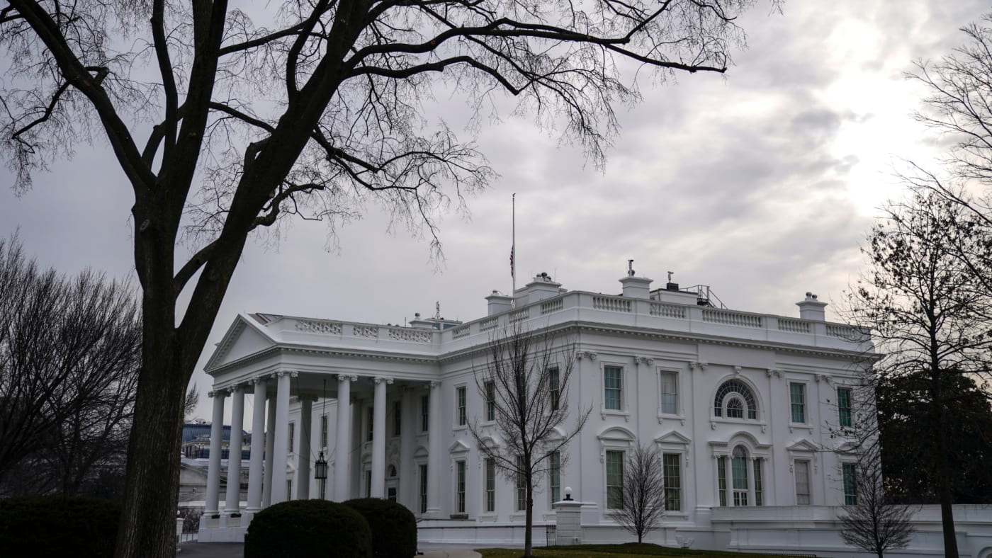 American flag flies at half staff over the White House.