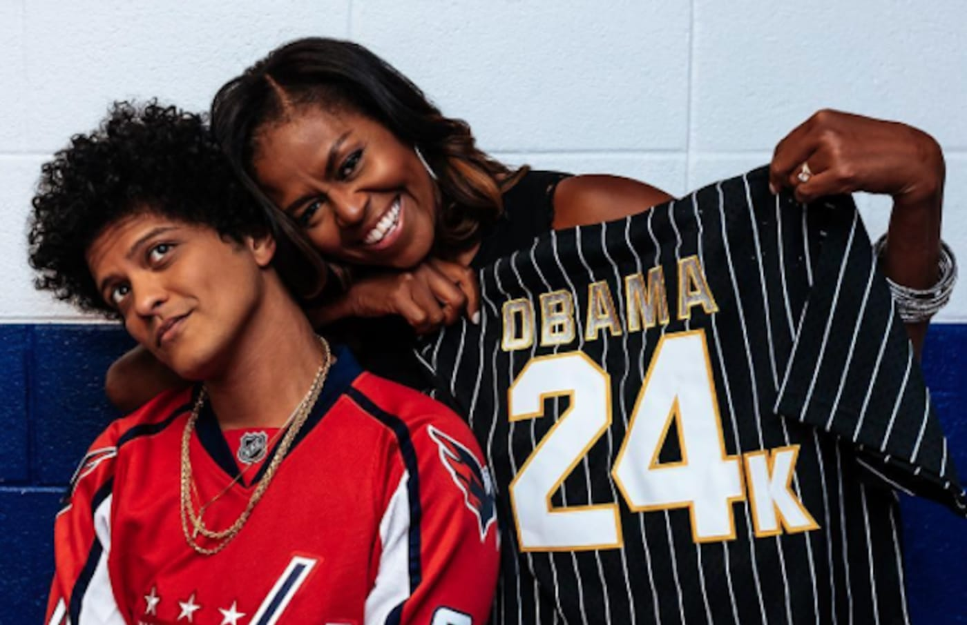 Michelle Obama poses for photo with Bruno Mars.