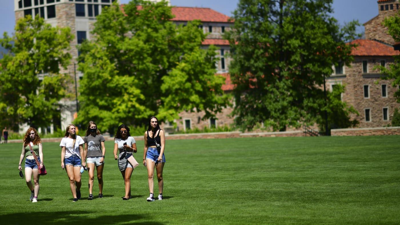 Freshmen walk through campus after moving into dormitories at University of Colorado Boulder