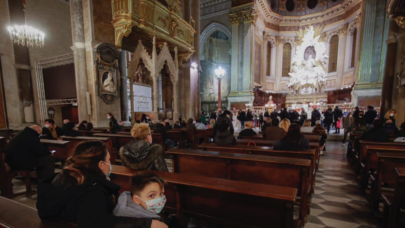 Parishioners wearing masks at a church service