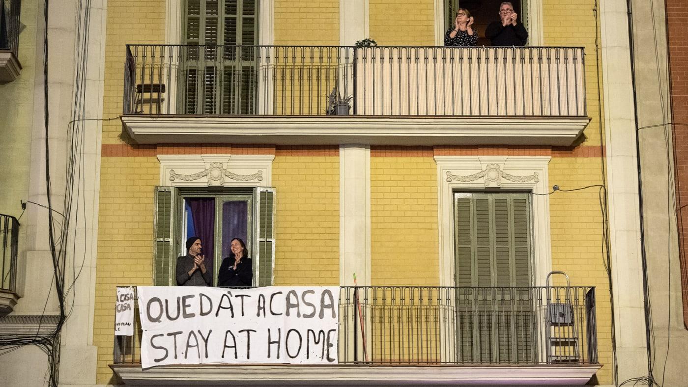People sit on balconies during COVID 19 lockdown