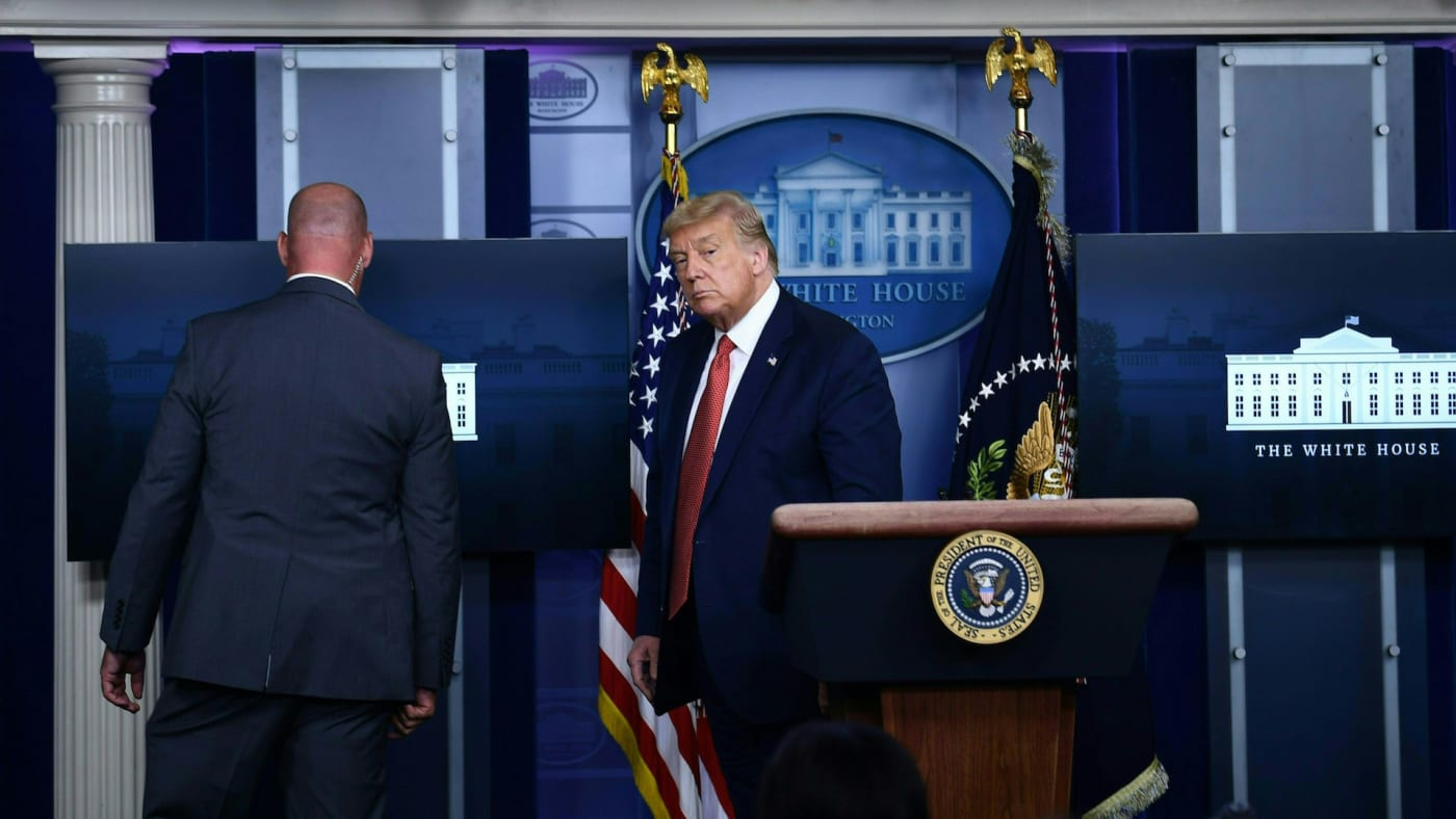 Donald Trump is being removed by secret service member from the Brady Briefing Room of White House.