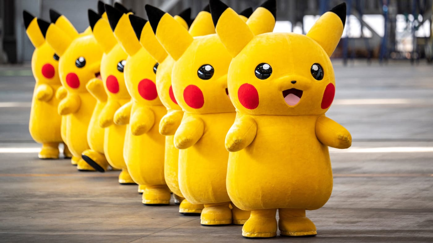 Pikachu mascots are seen during the unveiling of new Pokemon-themed livery on a Skymark Airlines plane.