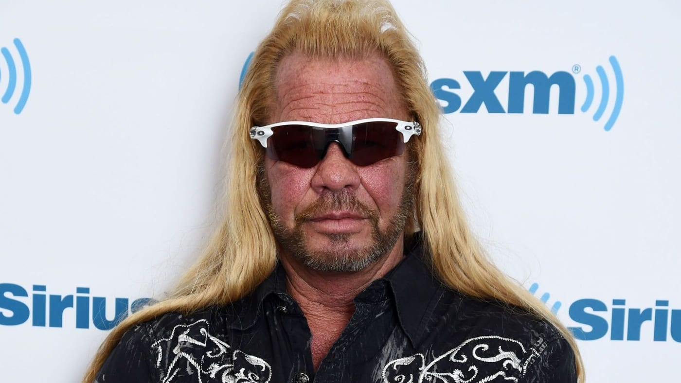 Dog the Bounty Hunter poses for a photo