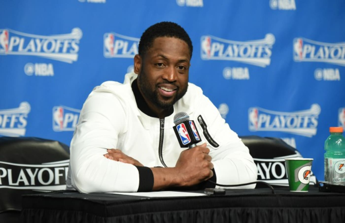 Dwyane Wade speaks with reporters after a playoff game.