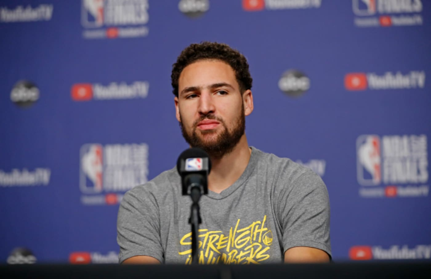 Klay Thompson #11 of the Golden State Warriors answers questions
