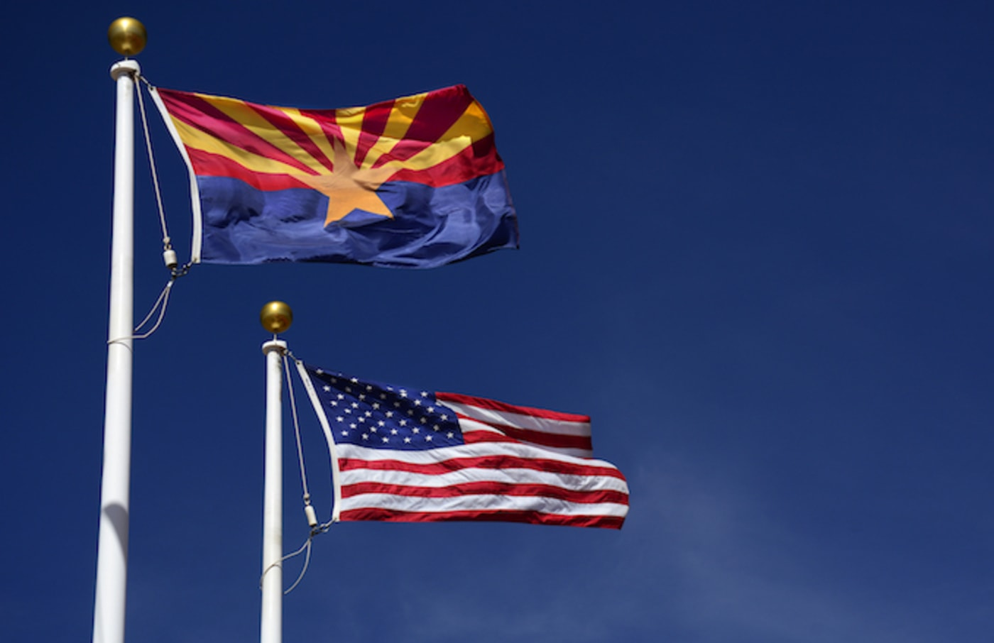 Arizona state flag flies beside the United States flag