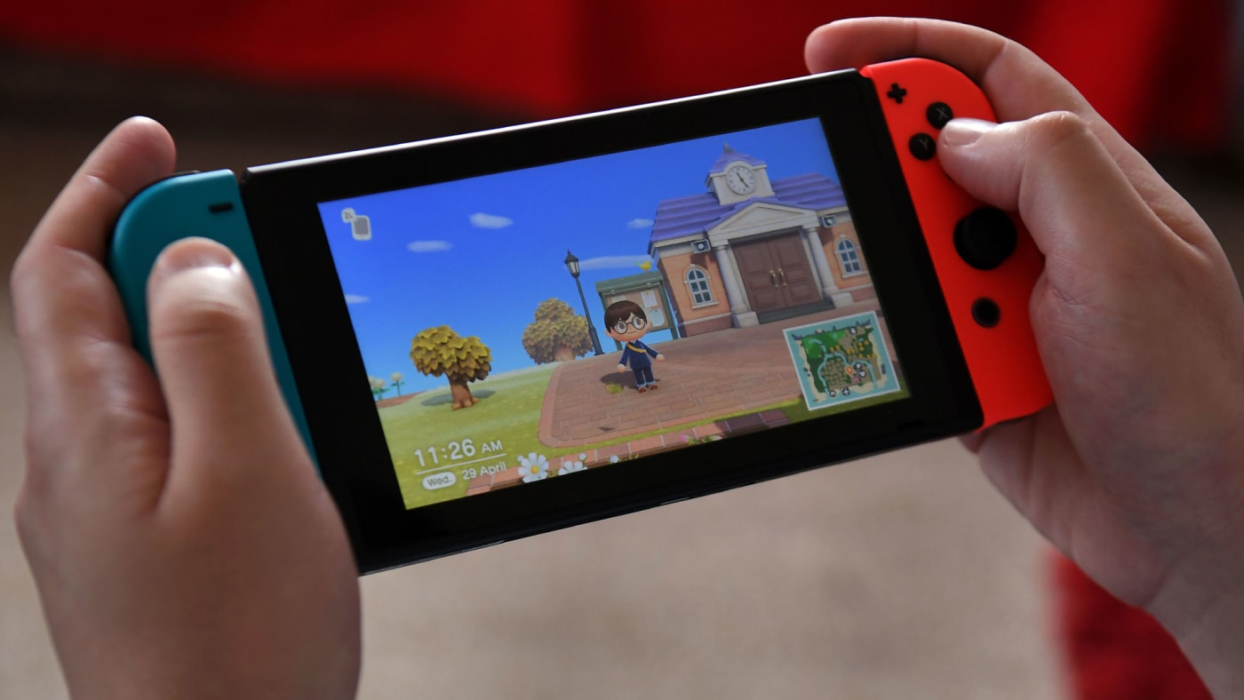 Someone playing 'Animal Crossing: New Horizons' on Switch