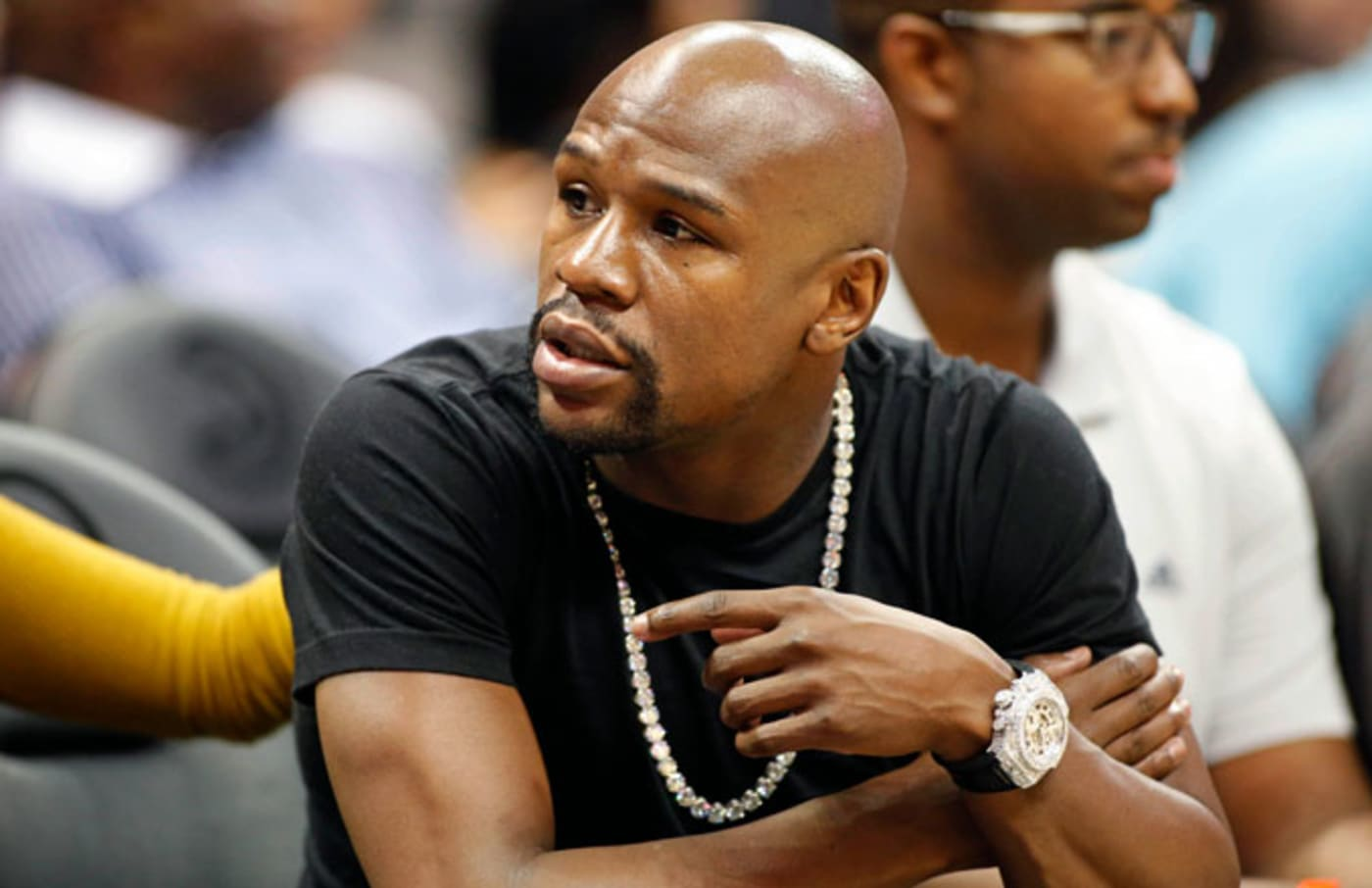 Floyd Mayweather attends an NBA game.