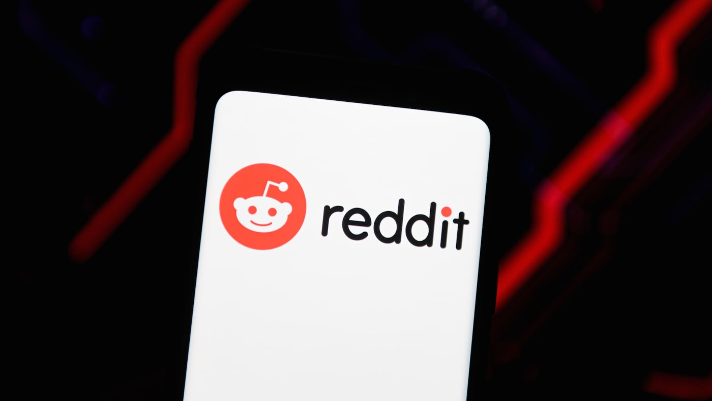 In this photo illustration a Reddit logo seen displayed on a smartphone.