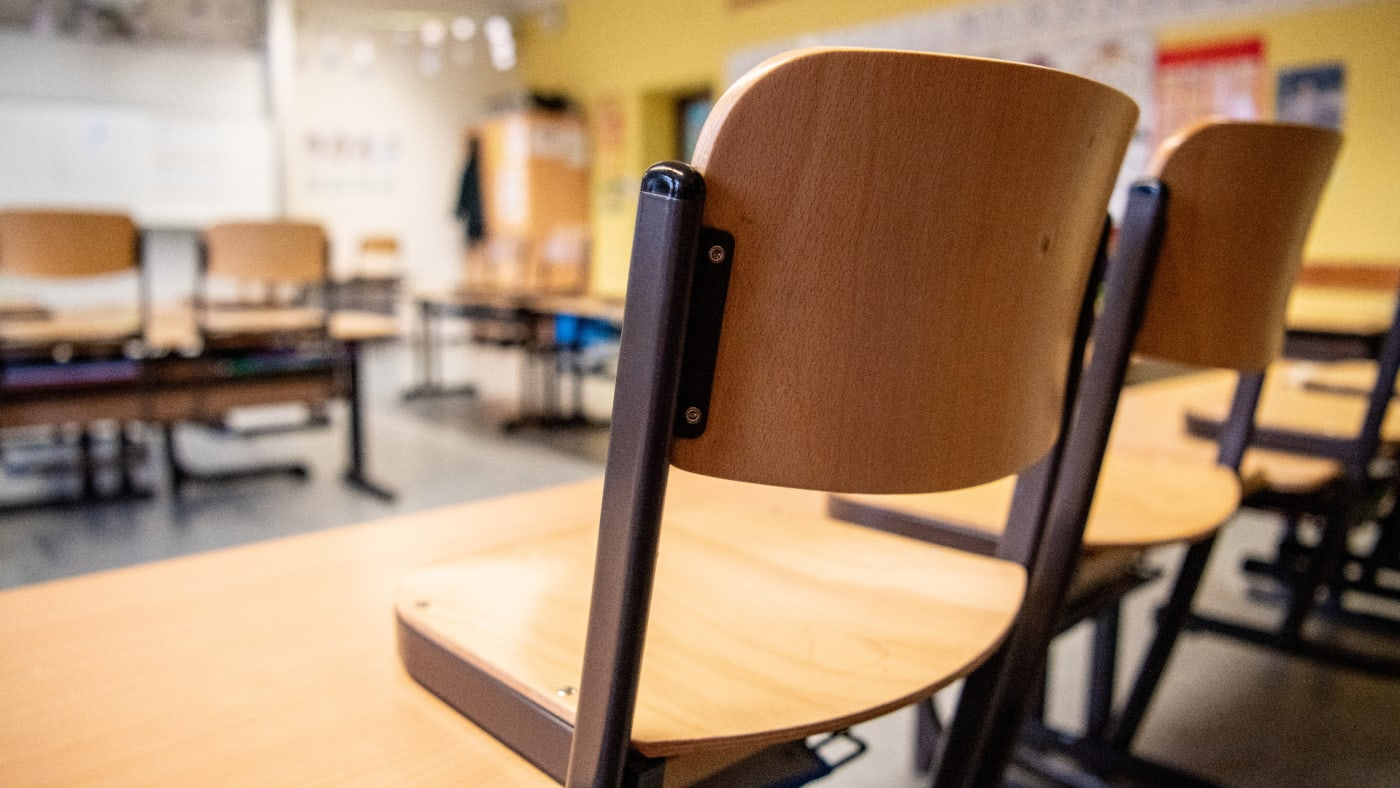 Chairs are placed on the tables in a classroom in a primary school.