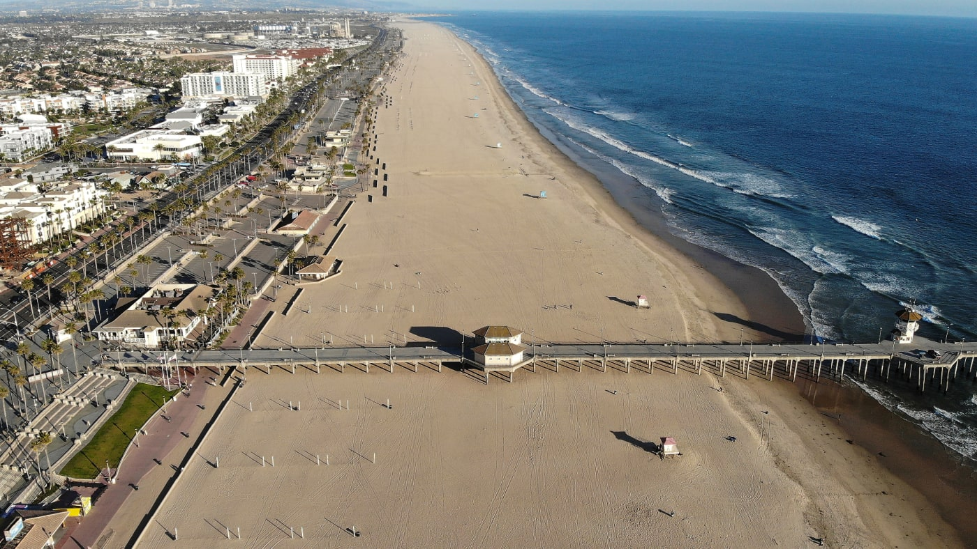 An aerial view of Huntington Beach and its shuttered pier amid the coronavirus pandemic.