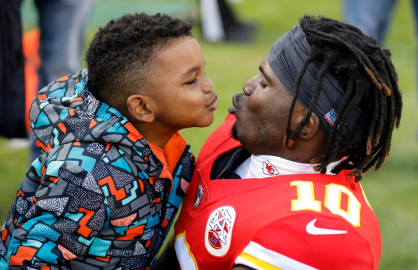 Tyreek Hill #10 of the Kansas City Chiefs teases his son