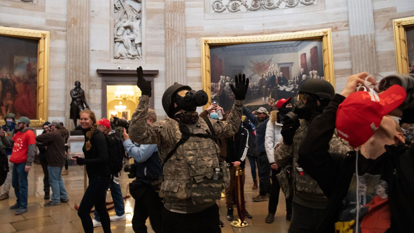 Chaos breaks out during the riot at the Capitol.