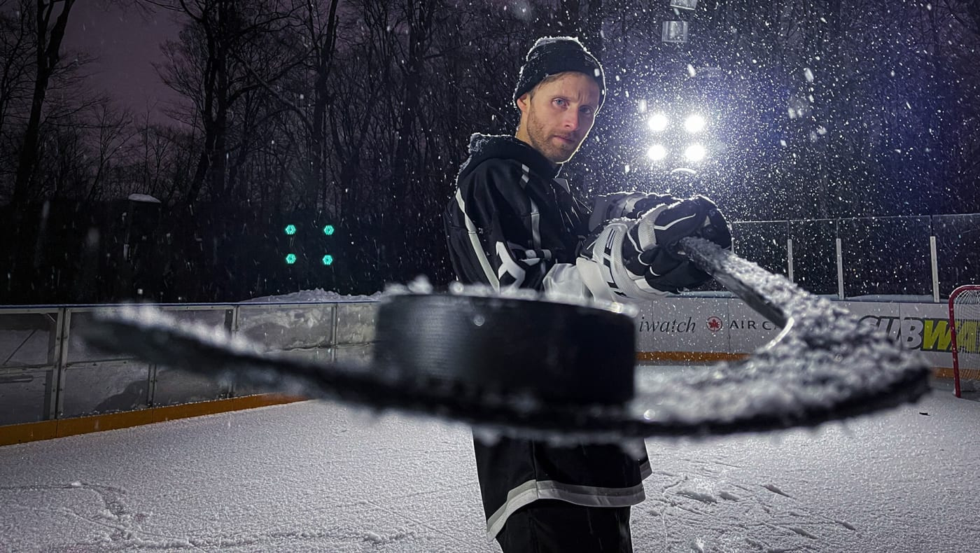 Mark Blinch poses with hockey stick