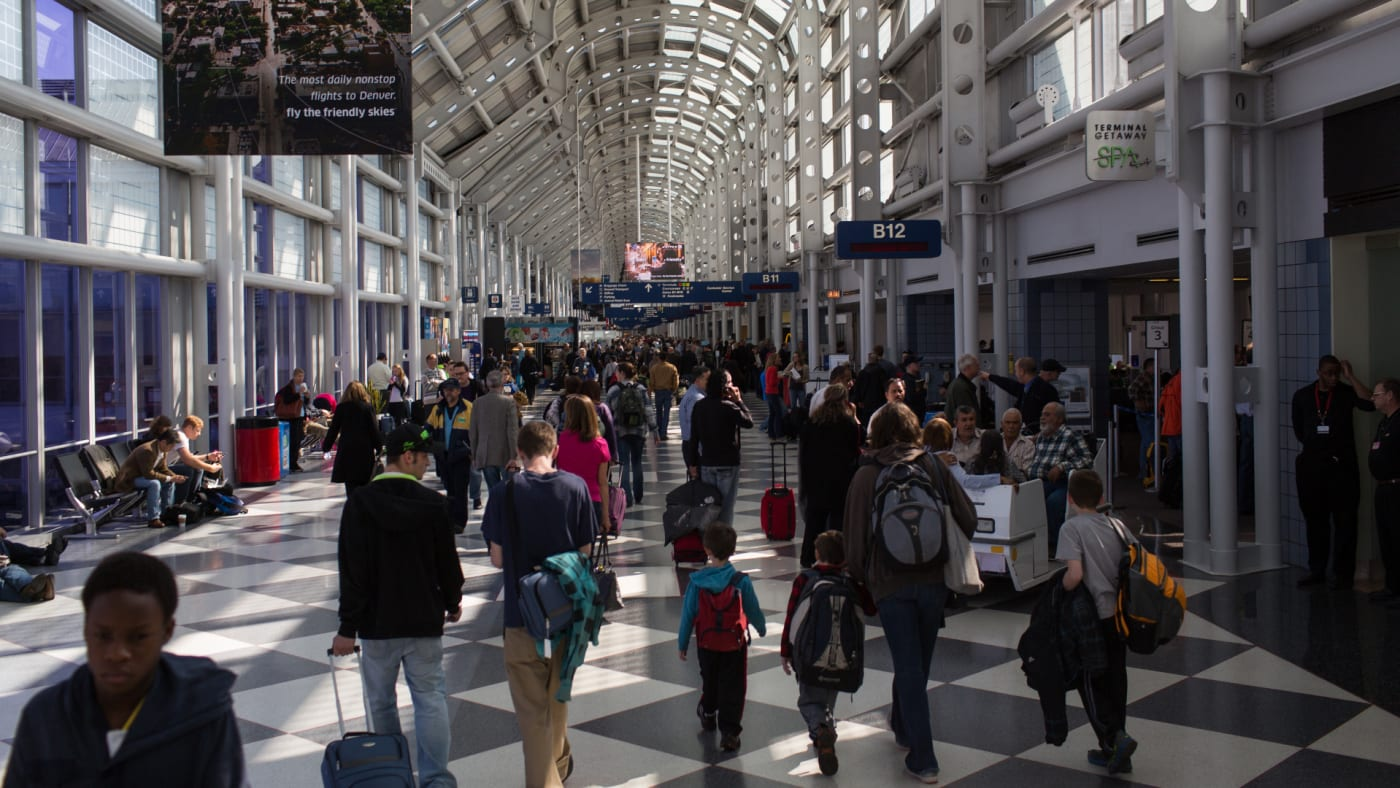 Traveling passengers walk to their flights at Chicago's O'Hare International Airport.