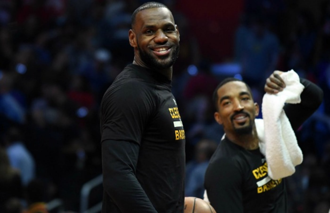 LeBron James laughs on the bench.