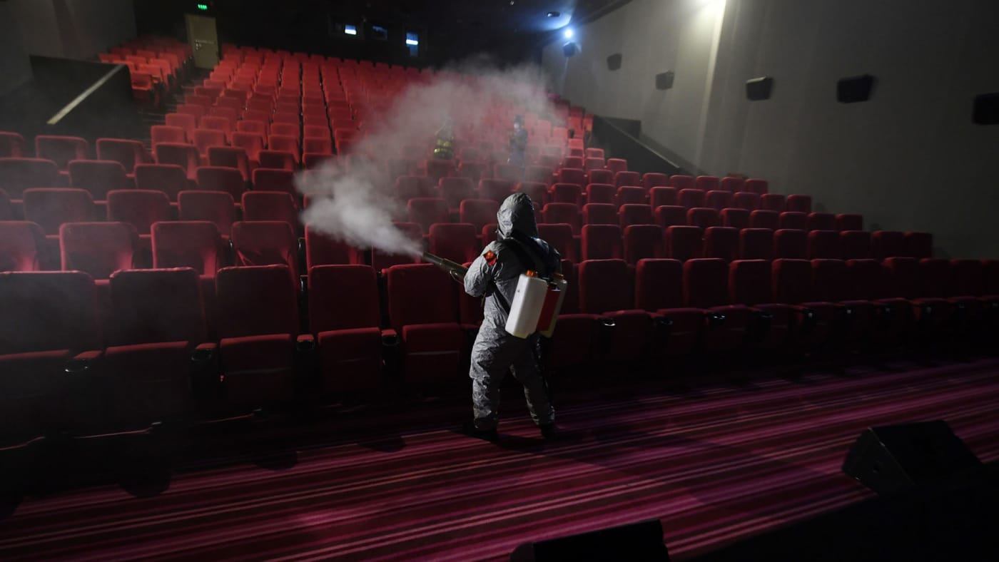 Cleaning between screenings at a Chinese cinema.