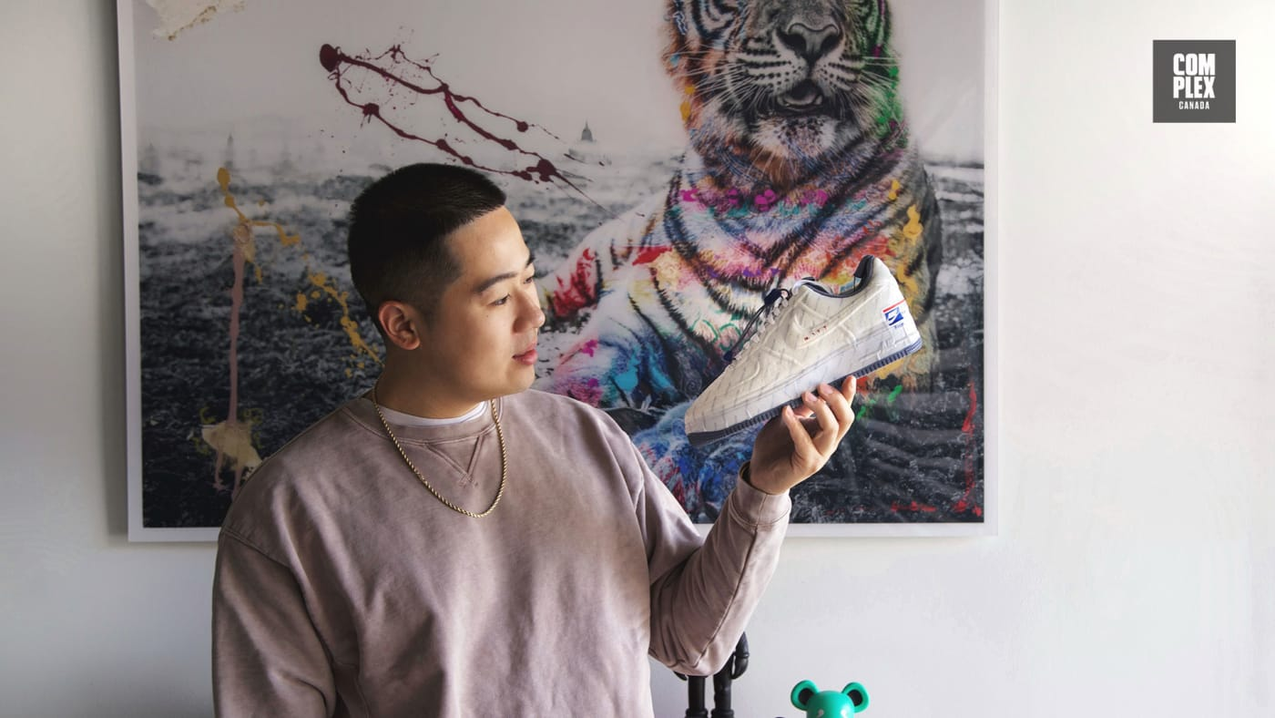 Andy Dang poses with the USPS x Nike Air Force 1