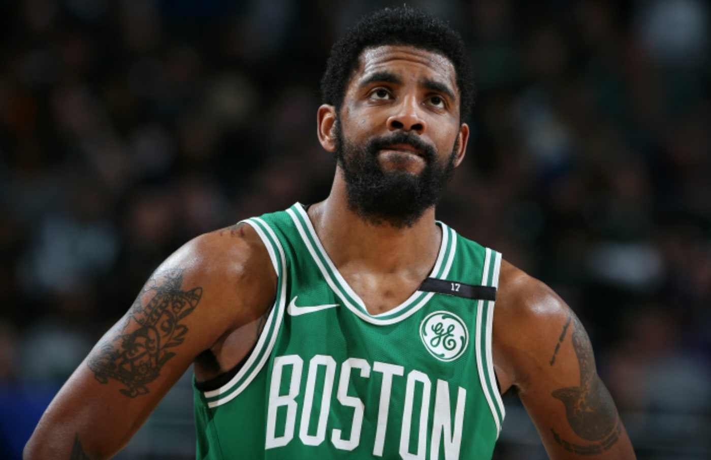 Kyrie Irving #11 of the Boston Celtics looks on during Game Five