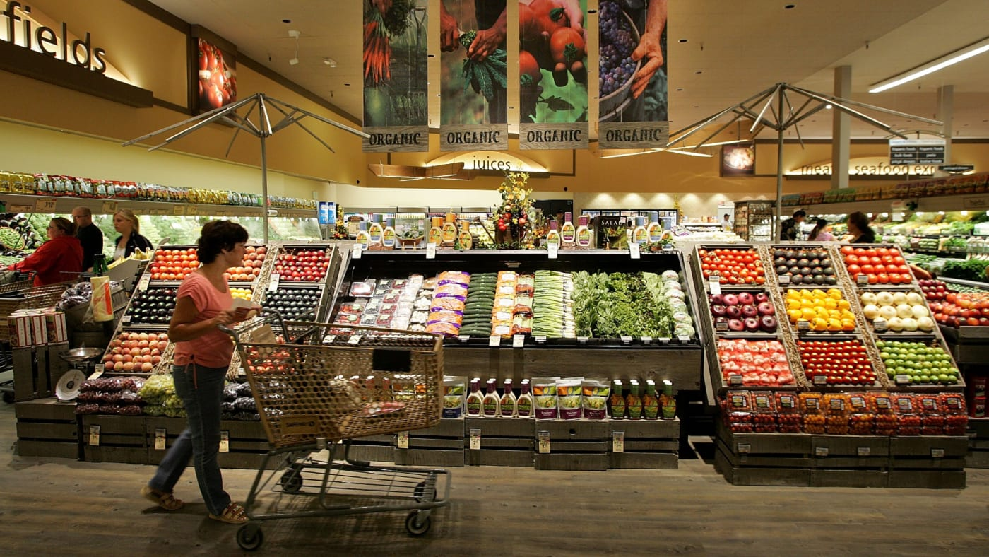 A Safeway customer browses in the fruit and vegetable section at Safeway.