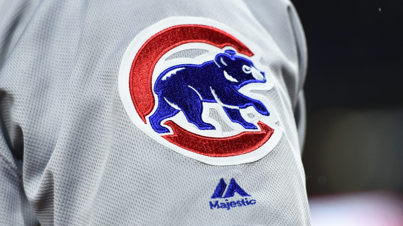 Chicago Cubs logo is displayed on the Majestic jersey.