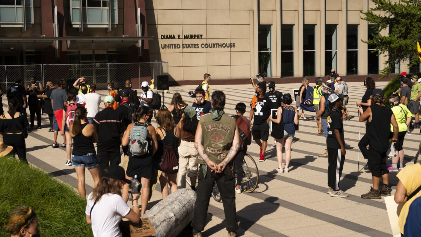People gather during a protest outside Diana E. Murphy United States Courthouse in Minneapolis.