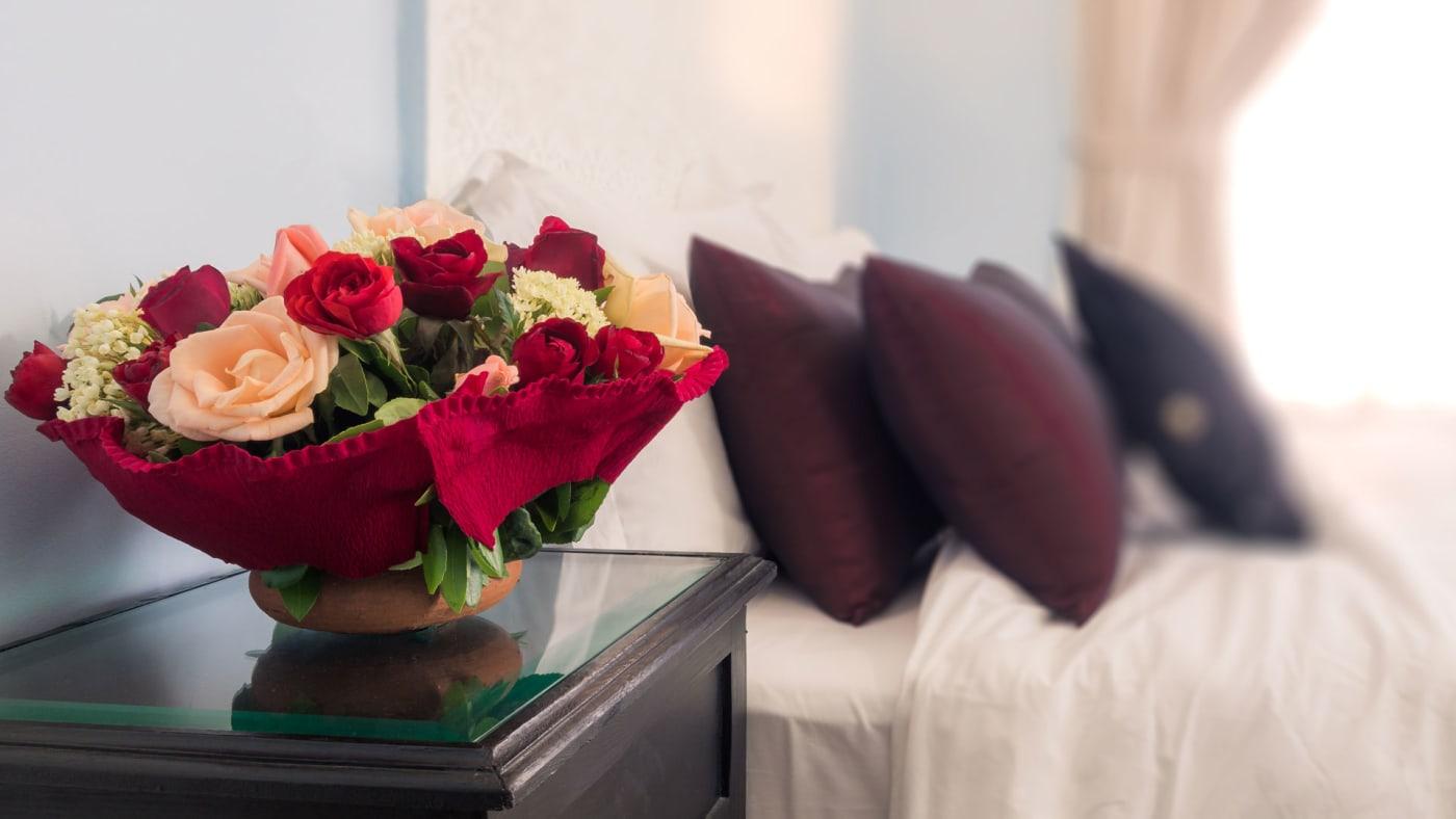 Flower arrangement in bedroom.