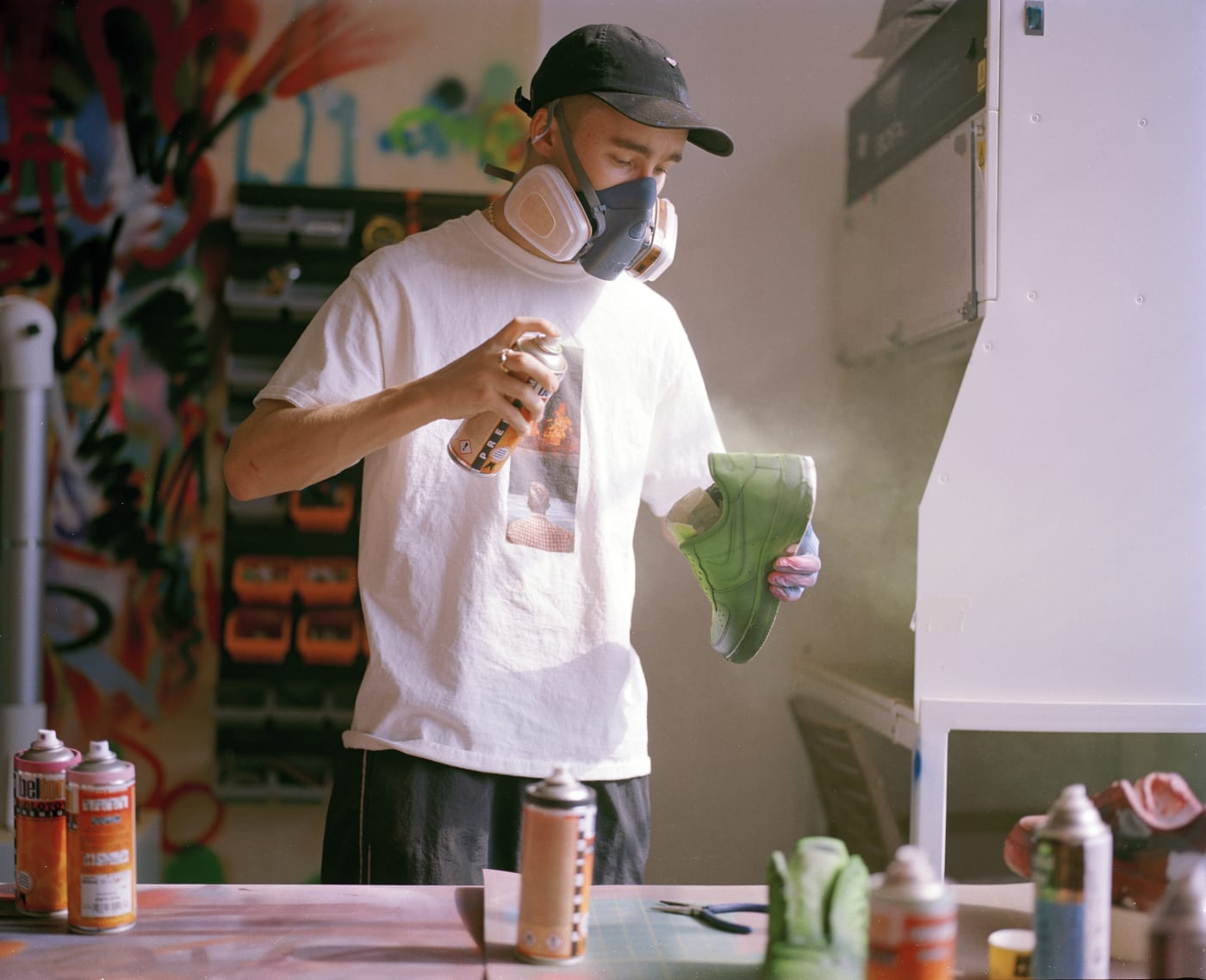Cassius Hirst Painting a Pair of Nike Air Force 1's