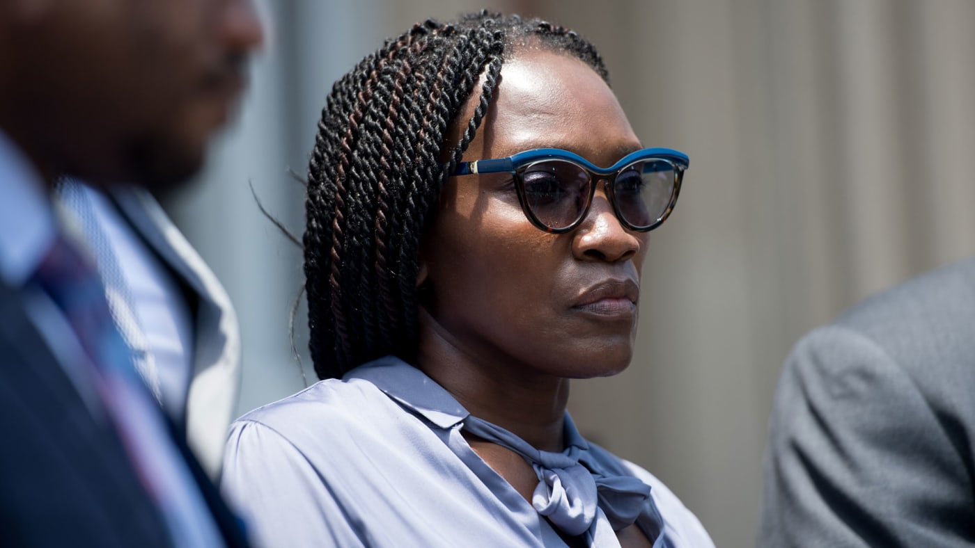 Wanda Cooper Jones, mother of Ahmaud Arbery, listens as attorneys speak outside courthouse.