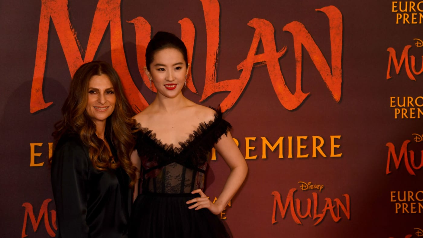 "Niki Caro and Yifei Liu attend the ""Mulan"" photocall."