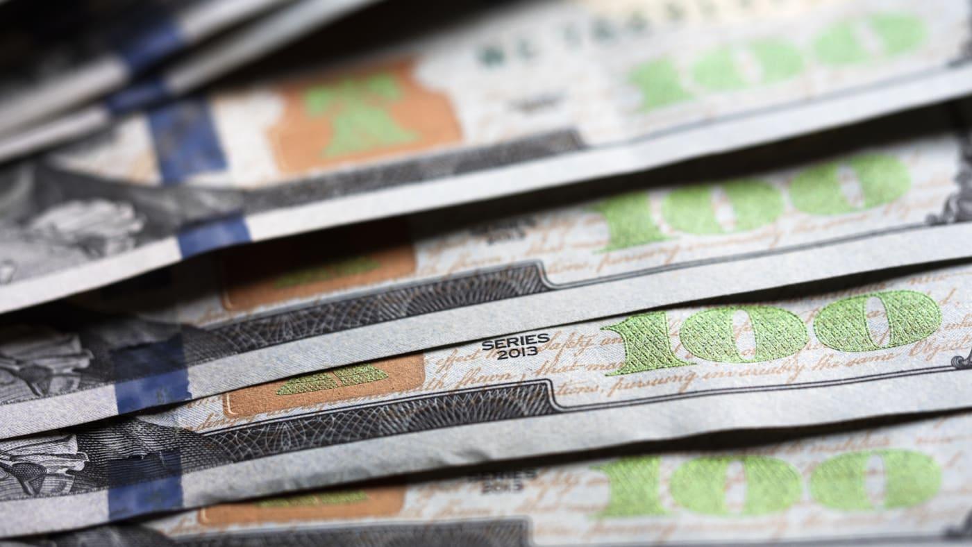 A photo illustration of US 100 dollar bills.