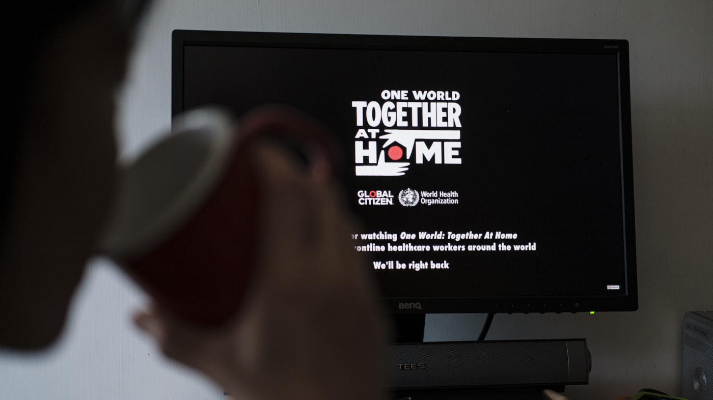 A person watches live streaming of One World Together At Home