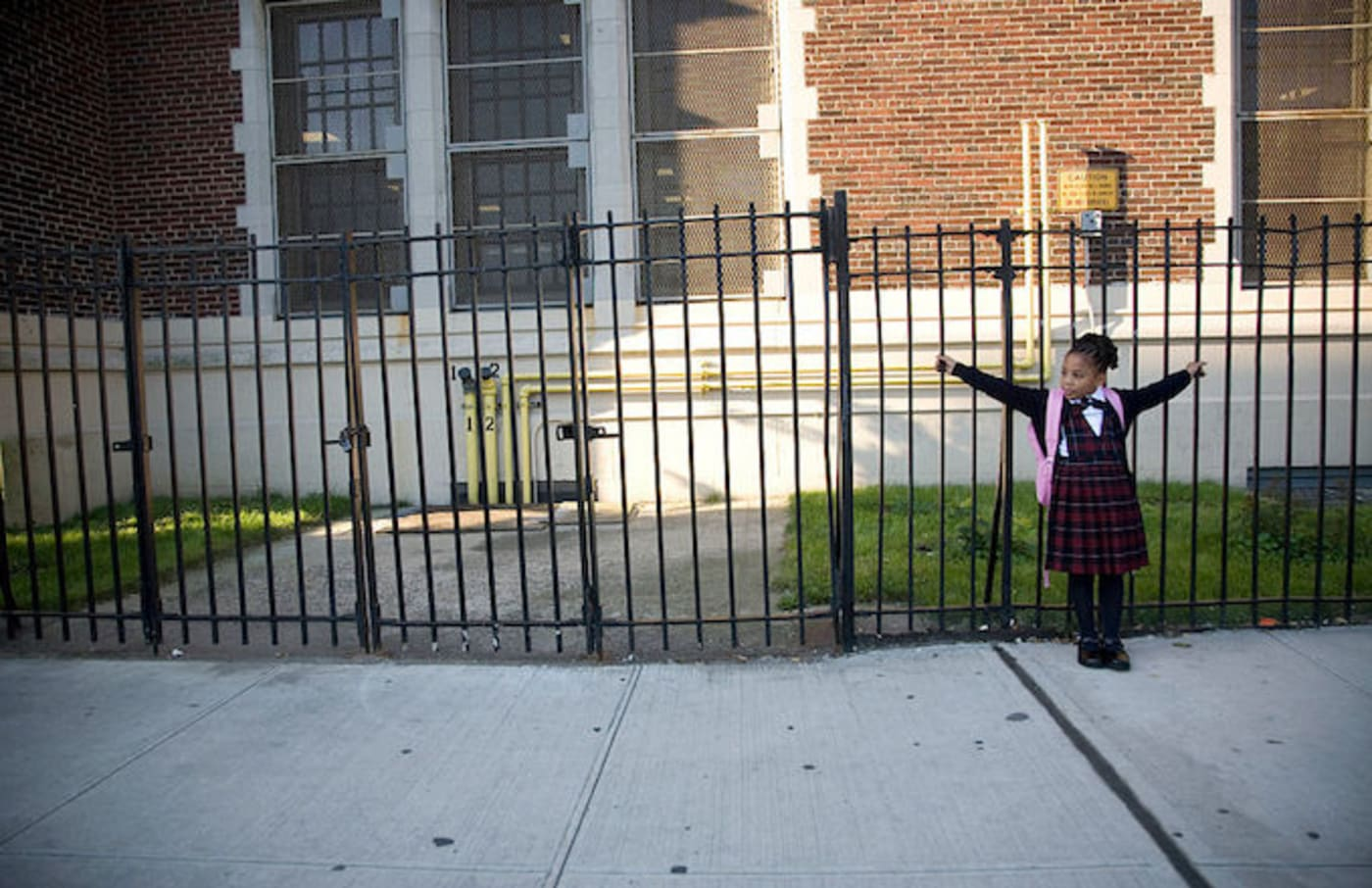 A child waiting outside a Bronx Public School in 2007.