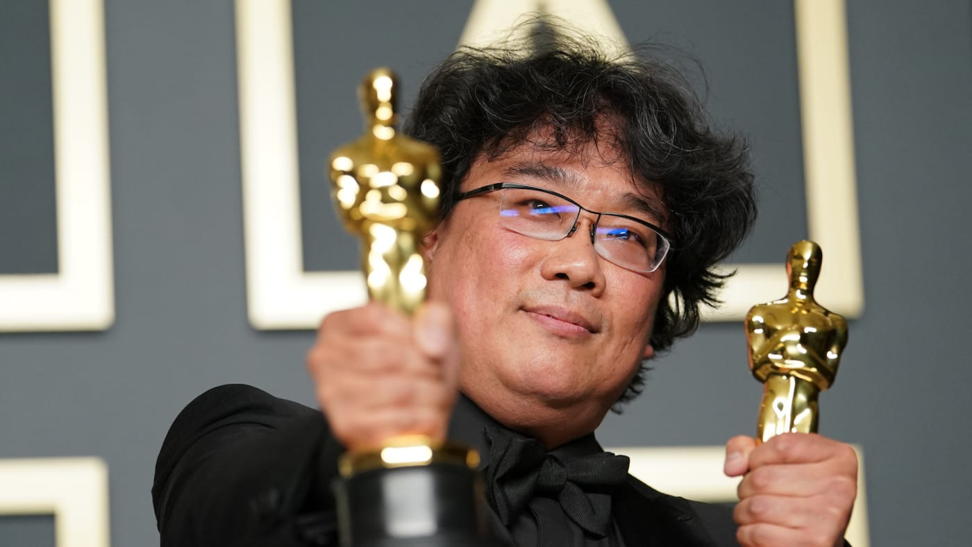 Bong Joon ho poses in the press room during the 92nd Annual Academy Awards.