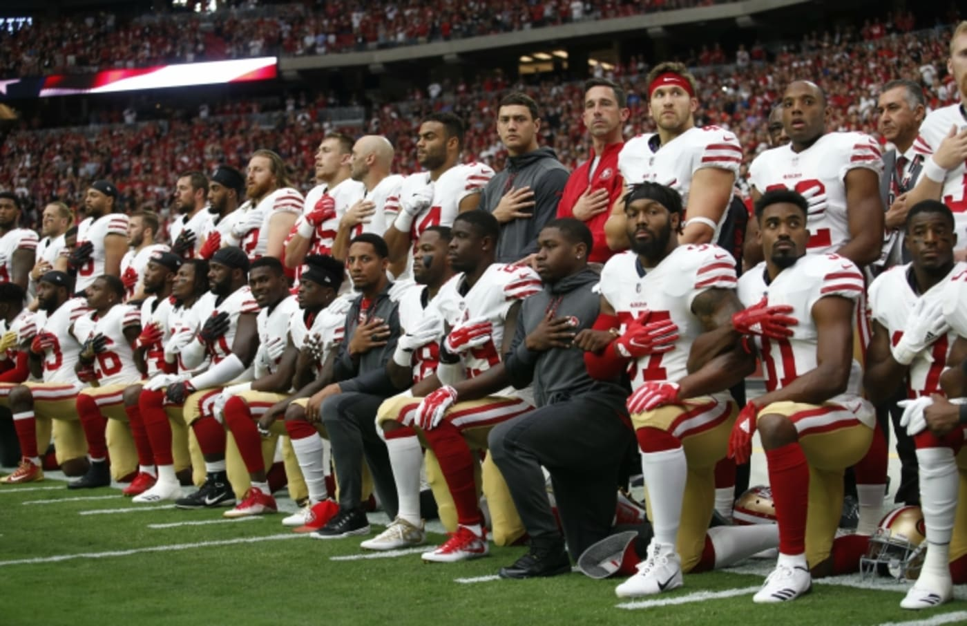 49ers players kneel during the national anthem.