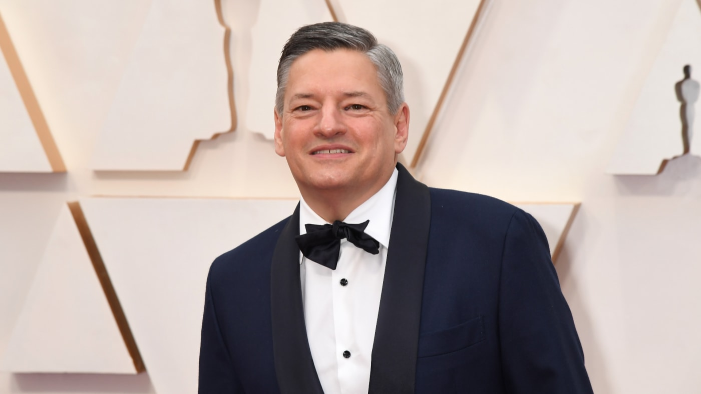 Ted Sarandos poses for photo on Oscars red carpet.