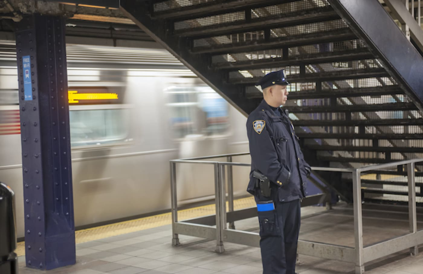 An NYPD officer is seen in the Times Square station in New York.