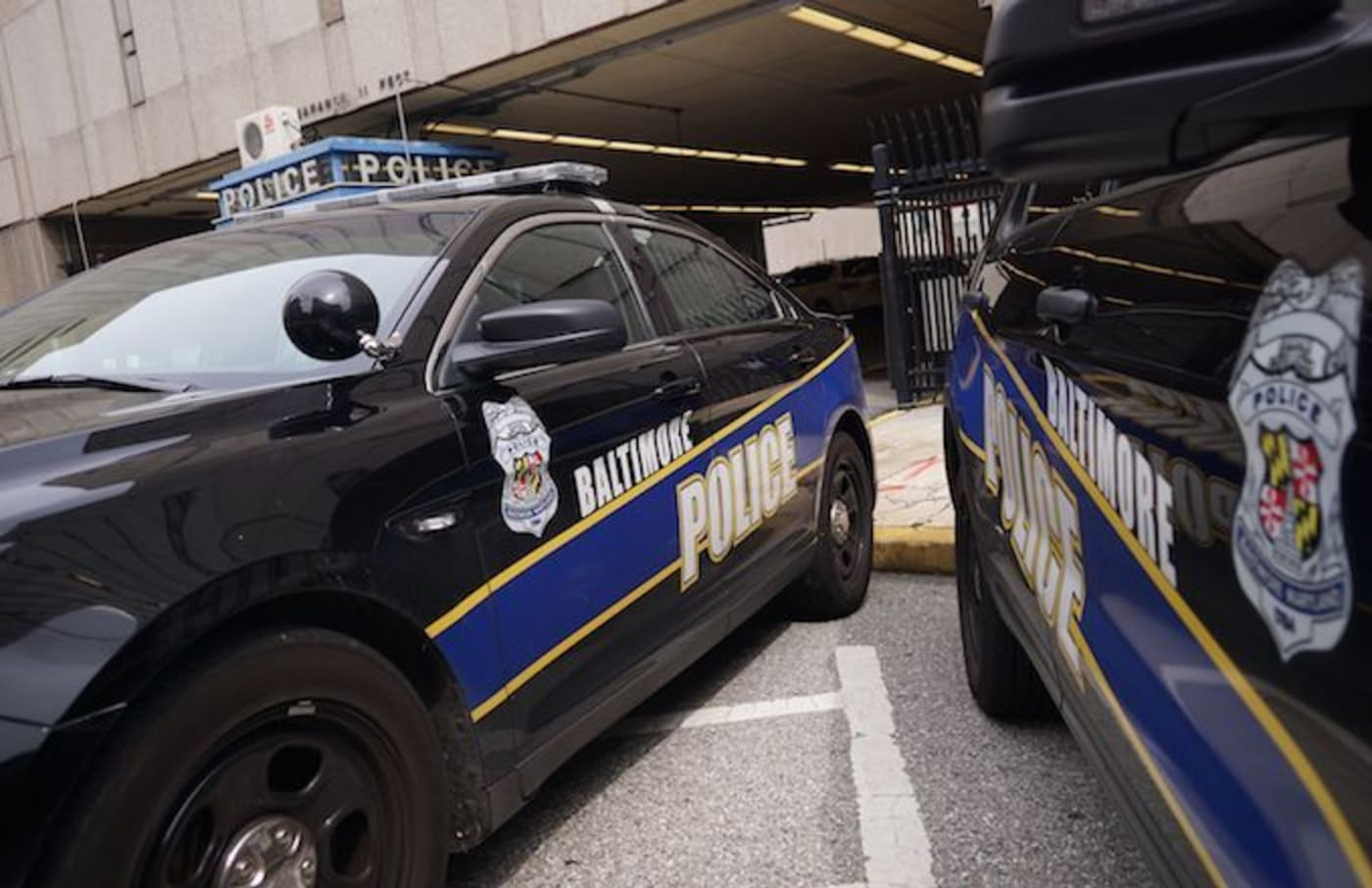 Police cars are seen outside of the Baltimore City Police Headquarters