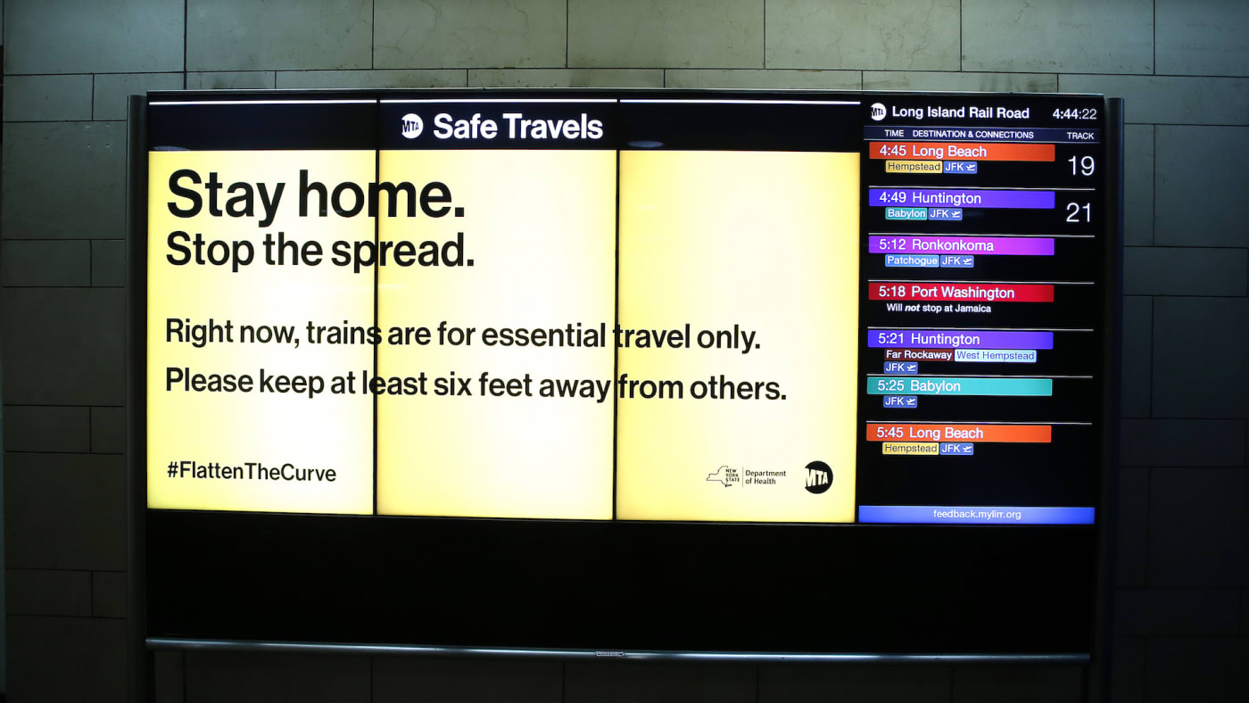 Train departures are displayed in Penn Station