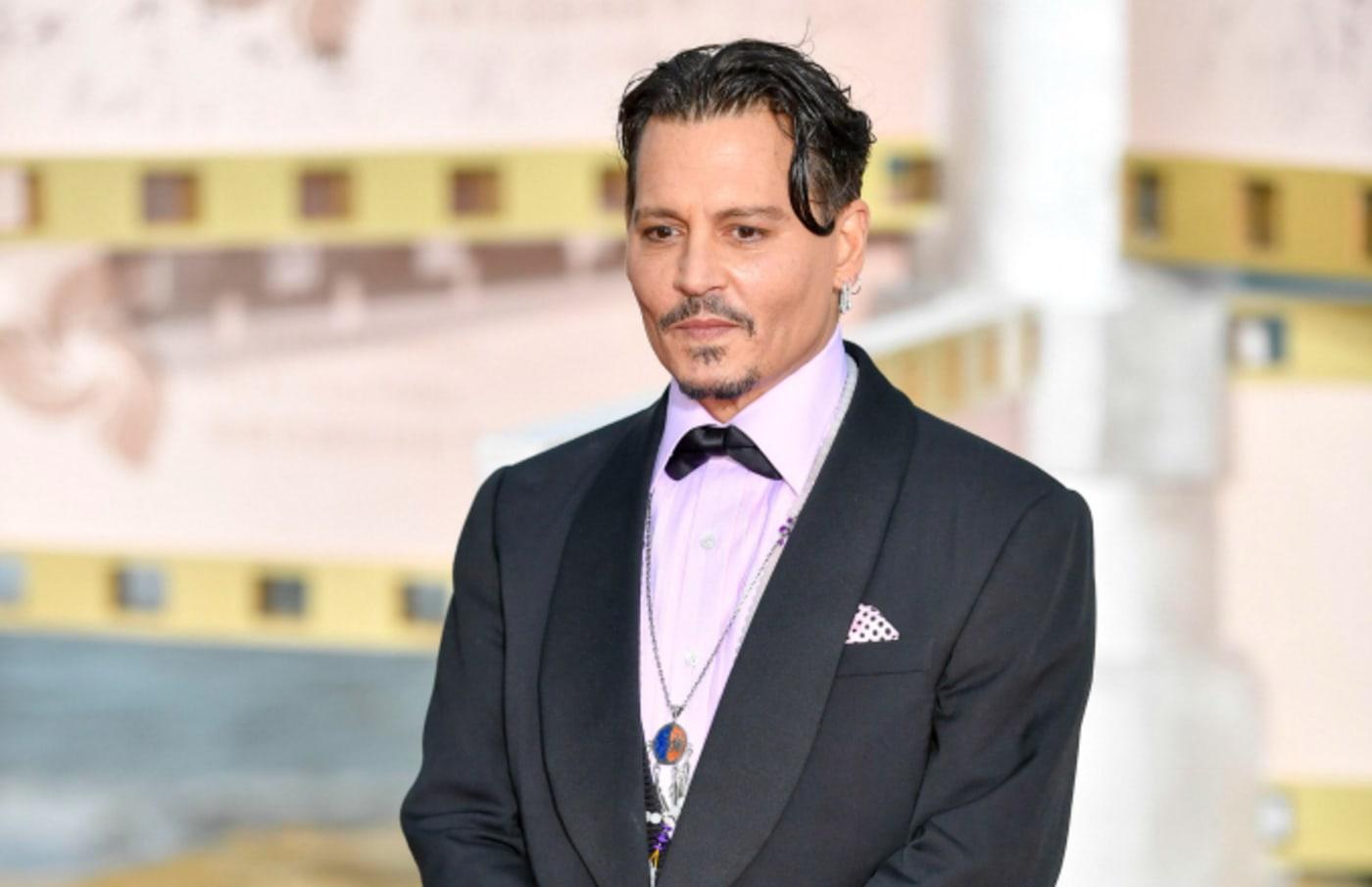 Johnny Depp arrives at the red carpet